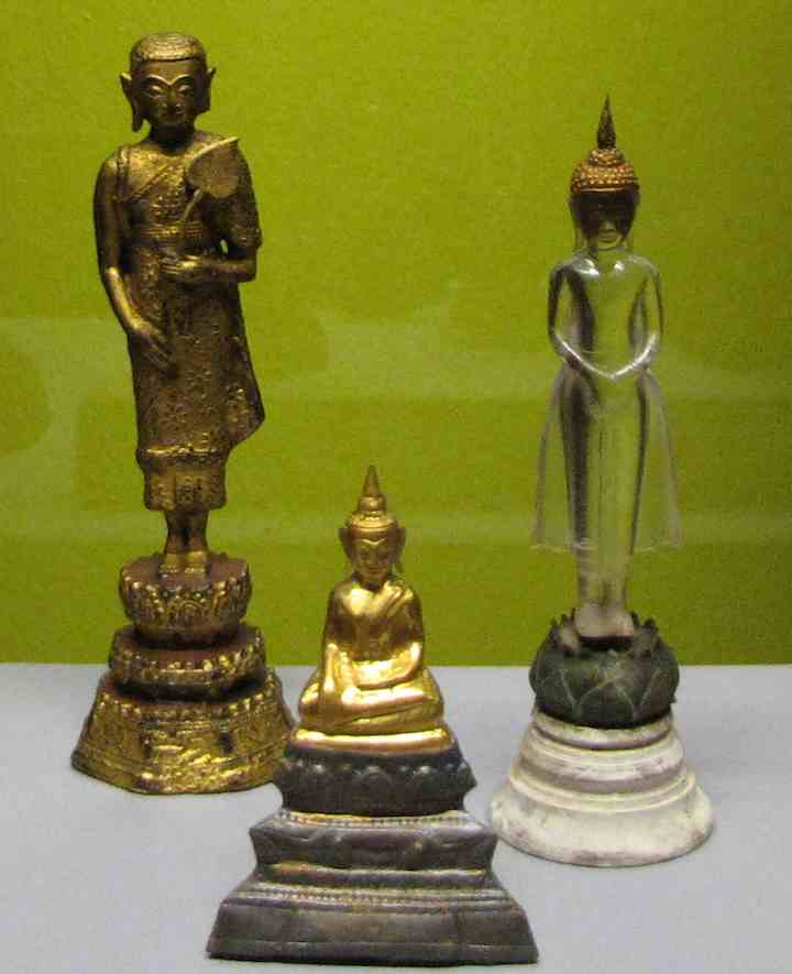 3 small buddha statues, including one in crystal at the Asian Civilization Museum in Singapore